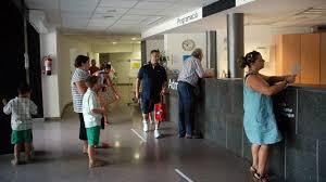 al taulell de hospital per demanar hora